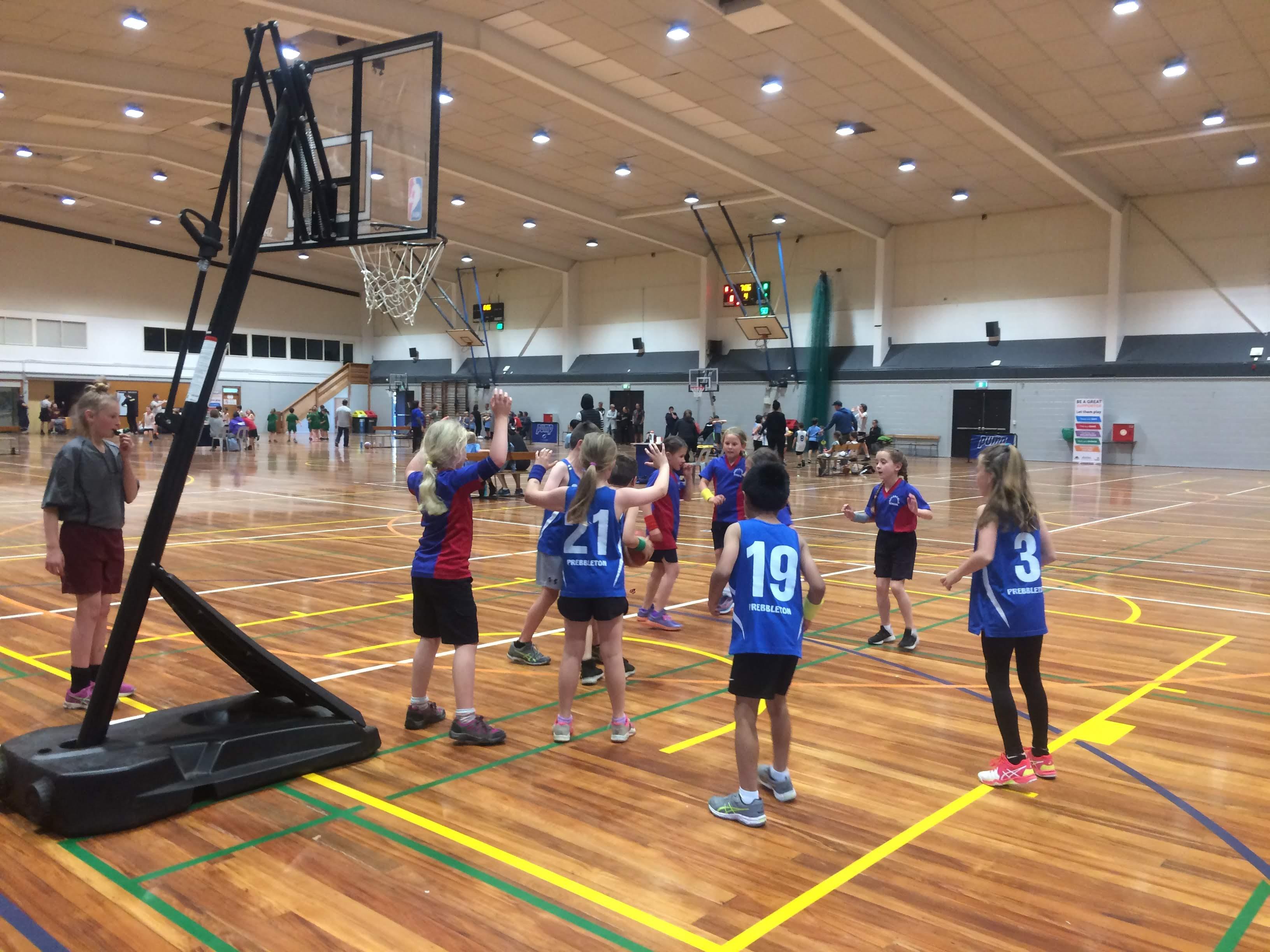 Somerfield Te Kura Wairepo basketball girls playing a match in an indoor court