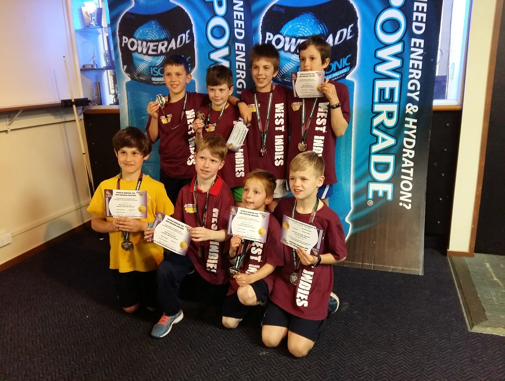 Indoor cricket team the somerfield smashers with their medals and certificates