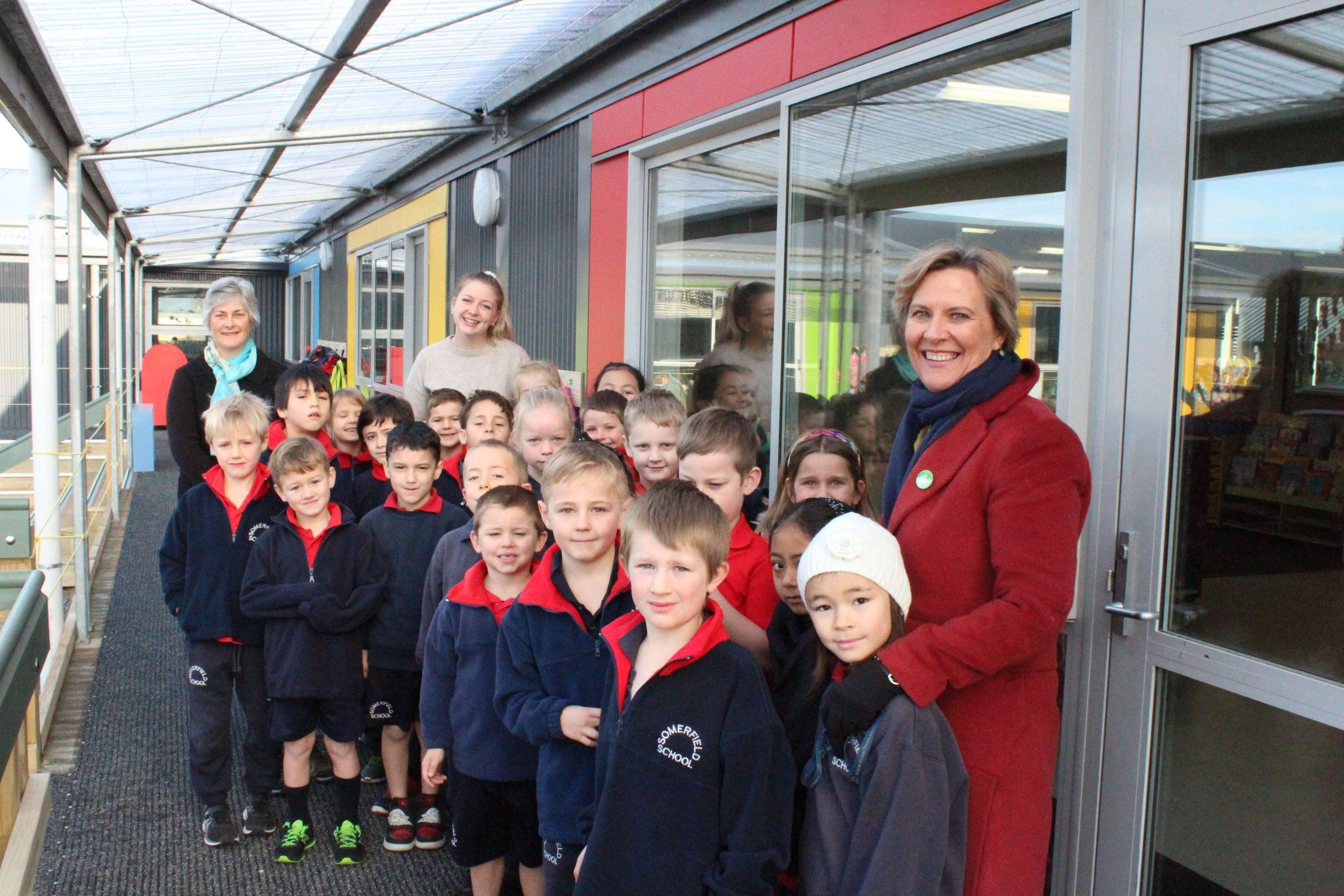 Somerfield Te Kura Wairepo students, teachers and principal standing on deck of new classroom